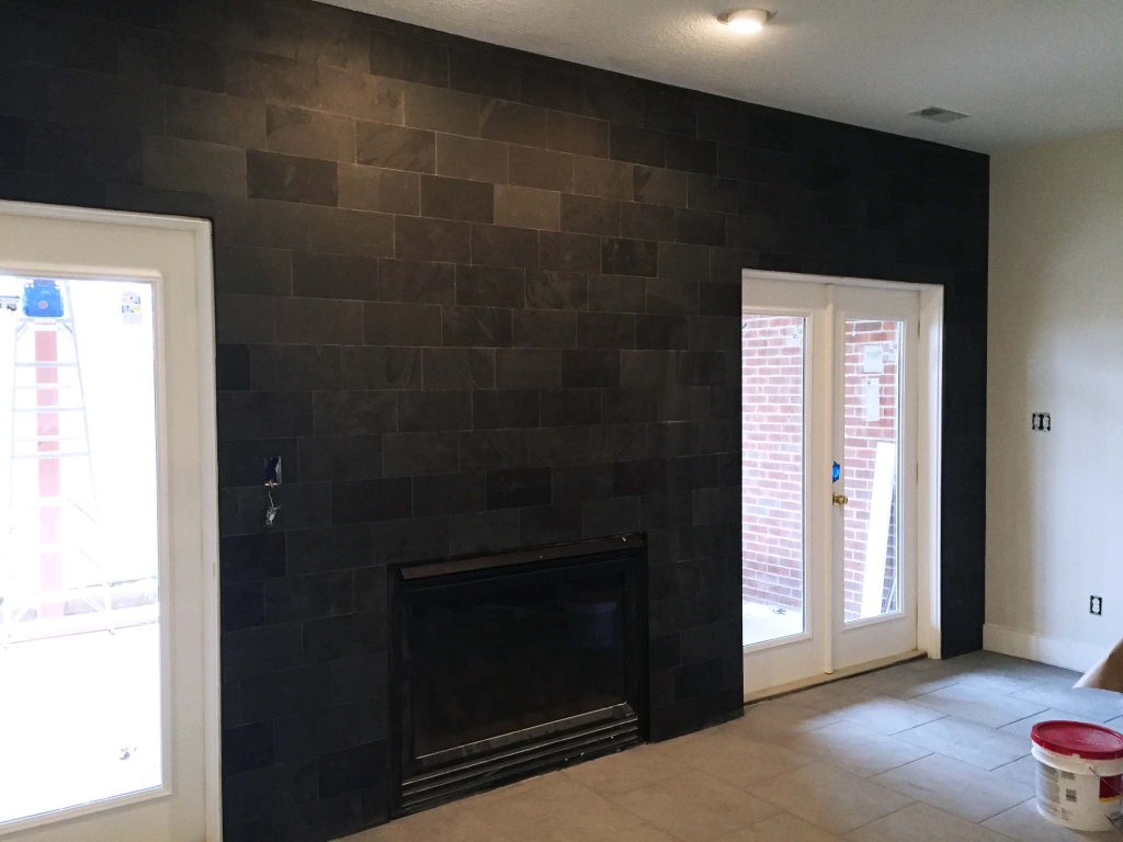 slate accent wall being installed