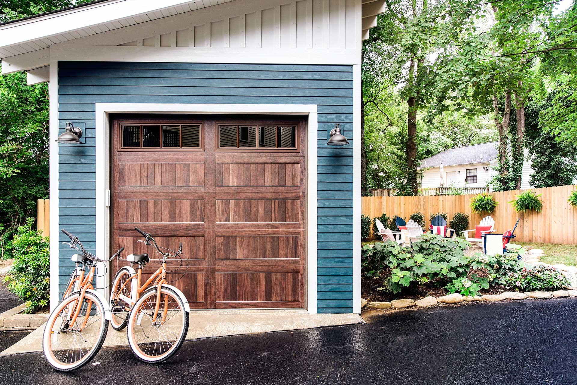 https://opendoorarchitecture.com/wp-content/uploads/2020/07/16_HGTV-Urban-Oasis-2017-Garage-with-Door-Closed.jpg